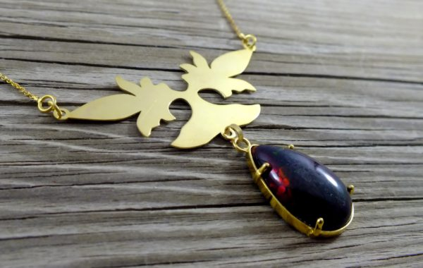 مدال طلا با سنگ اوپال مشکی